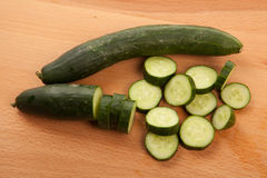 Cucumbers on wooden table Royalty Free Stock Images