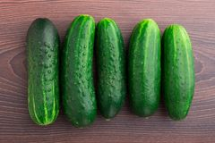 Cucumbers on wooden table Stock Photos