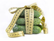 Cucumbers with yellow measuring tape Stock Photography