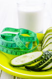 Cucumbers, yogurt and centimeter. For dieting Royalty Free Stock Image