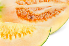 Cucumis melo or melon with half and seeds on white (Other names Stock Photography