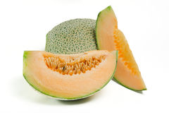 Cucumis melo or melon with half and seeds on white (Other names Stock Images