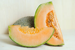 Cucumis melo or melon with half and seeds on wooden plate (Other Stock Photography