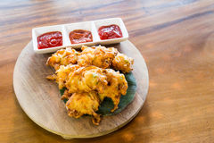 Cucur bawang or onion fritters, popular Malaysia food. Cucur bawang or onion fritters with dips, popular Malaysia food Royalty Free Stock Photo
