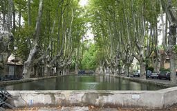 Cucuron. Pond set in avenue of trees in Cucuron, Luberon France royalty free stock images