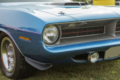 Cuda front end. Closeup of blue 1970 plymouth cuda front end with shaker hood scoop stock photography