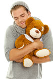 Cuddle toy. Man with cuddle toy in his arms royalty free stock image