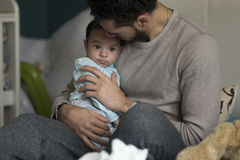 Cuddles with daddy Royalty Free Stock Images