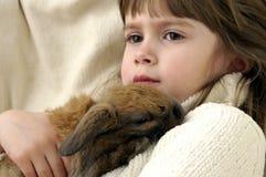 Cuddling. A young girl cuddling her pet bunny stock photos