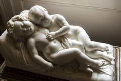 Cuddling Cherubs Osborne House. Osborne House is a former royal residence in East Cowes, Isle of Wight, United Kingdom. The house was built between 1845 and stock photo