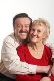 Cuddling couple Stock Images