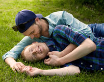 Cuddling Couple. An image of a happy gay couple cuddling outdoors Stock Photos