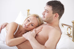 Cuddling Couple In Bed Stock Photography