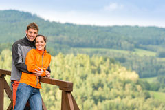 Loving couple on romantic summertime weekend hill. Cuddling couple on a summer weekend at the top of the mountain Stock Photography