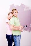 Cuddling DIY couple stock photography