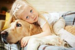 Cuddling dog Royalty Free Stock Images