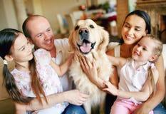 Cuddling dog Royalty Free Stock Photos