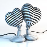 Cuddling Microphones Royalty Free Stock Image