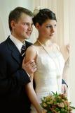 Cuddling newlywed couple royalty free stock photography