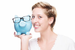 Cuddling with a piggy bank Stock Image