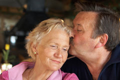 Cuddling seniors Stock Photography