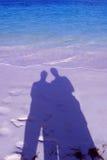Cuddling shadows. Shadow of cuddling couple on a beach in Bermuda Stock Photo