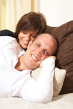 Cuddling on the sofa Stock Images