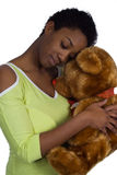 Cuddling with a teddy bear Royalty Free Stock Photo