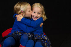 Cuddling twins twins Stock Image