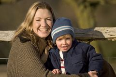 Cuddling Up. A mother and her young son in the English countryside stock photo