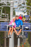Cuddling young couple sitting on chair lift Royalty Free Stock Photos