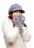 Cuddly girl in warm winter clothing. Pretty young woman wearing warm winter clothing: hat, gloves, scarf and fluffy jumper Stock Image