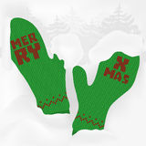 Cuddly green vintage knitted mittens. A trendy Christmas design for market presence with green cuddly knitted mittens, firs and snowdrifts. Is ideal for Royalty Free Stock Photography