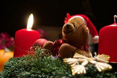 Cuddly Toy with christmas candles Royalty Free Stock Photo
