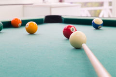 Cue aiming red ball into snooker billards table pocket. Cue aiming red ball into snooker pool billards table pocket Royalty Free Stock Photos