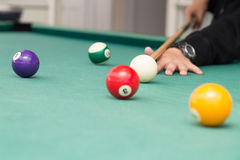 Cue aiming red ball into snooker billards table pocket. Cue aiming red ball into snooker pool billards table pocket Royalty Free Stock Photo