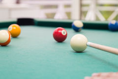 Cue aiming red ball into snooker billards table pocket. Cue aiming red ball into snooker pool billards table pocket Royalty Free Stock Photography
