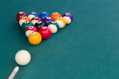Cue aiming white ball to break snooker billards on table. Cue aiming white ball to break snooker billards on green table Stock Images