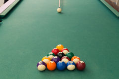 Cue aiming white ball to break snooker billards on table. Cue aiming white ball to break snooker billards on green table Royalty Free Stock Photography