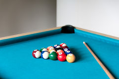 Cue and balls are on the table Stock Image