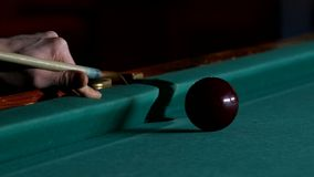 Cue hits red pool ball stock video footage