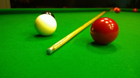 Cue and snooker balls royalty free stock image