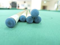 Cue stick. S on green table indoors Stock Photography