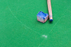 Cue stick with chalk block.  Royalty Free Stock Images