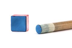 Cue stick with chalk block. Stock Images