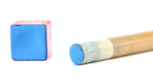 Cue stick with chalk block. Royalty Free Stock Image