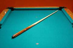 Cue stick on a pool table. Cue stick on a green pool table stock photography