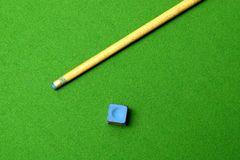 Cue stick wit chalk block. Shallow depth of field Royalty Free Stock Images