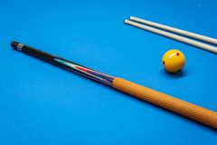 Cue sticks and a yellow ball royalty free stock photo