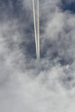 Cueing Plane between Clouds Royalty Free Stock Photo